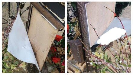 На кладбище в Воронеже неизвестные изрезали ножом портреты умерших